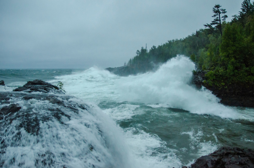 Water flowing over the Black Rocks after a giant Lake Superior wave crashes into the shoreline at Presque Isle park. Marquette, MI