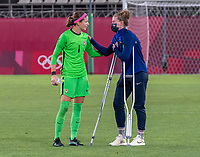 KASHIMA, JAPAN - AUGUST 2: Stephanie Labbe #1 of Canada talks with Alyssa Naeher #1 of the USWNT after a game between Canada and USWNT at Kashima Soccer Stadium on August 2, 2021 in Kashima, Japan.