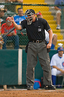 Home plate umpire Brandon Henson signals a strike during a Florida State League game between the Dunedin Blue Jays and the Daytona Cubs at Jackie Robinson Stadium June 18, 2010, in Daytona Beach, Florida.  Photo by Brian Westerholt /  Seam Images