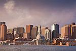 A winter sunrise on the skyline of Boston harbor, Boston, MA, USA