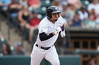 Luis Curbelo (16) of the Winston-Salem Dash hustles down the first base line against the Greensboro Grasshoppers at Truist Stadium on June 19, 2021 in Winston-Salem, North Carolina. (Brian Westerholt/Four Seam Images)
