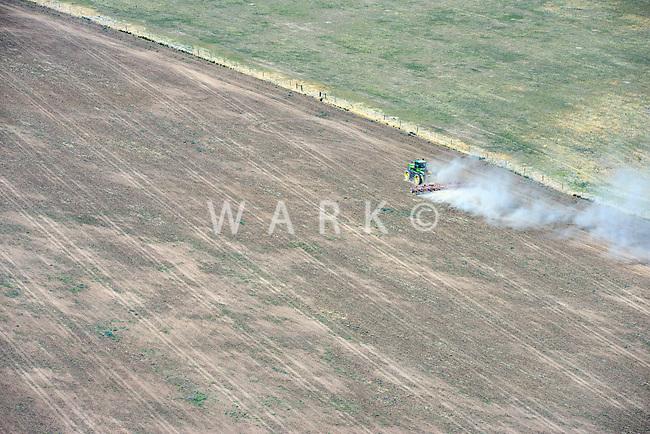 Tractor working dry prairie land, eastern Colorado