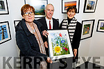 Lily O'Sullivan showing her photo Wildflower Garden to Tommy O'Connell (County Librarian) and Cllr Norma Foley at the Ardfert camera club photo exhibition in the County Library in Tralee on Tuesday