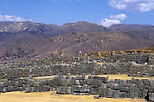 Cusco, Peru. Inca stonework at Sacsayhuaman with mountains behind.