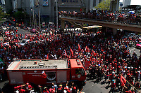"""""""Red Shirt"""" protesters cheer as fire engines withdraw along with the military on Ploenchit road in Central Bangkok."""