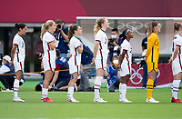 TOKYO, JAPAN - JULY 21: The USWNT stands for anthems before a game between Sweden and USWNT at Tokyo Stadium on July 21, 2021 in Tokyo, Japan.