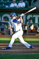 DJ Peters (27) of the Ogden Raptors follows through on his swing against the Grand Junction Rockies during the Pioneer League game at Lindquist Field on August 24, 2016 in Ogden, Utah. The Raptors defeated the Rockies 11-10. (Stephen Smith/Four Seam Images)
