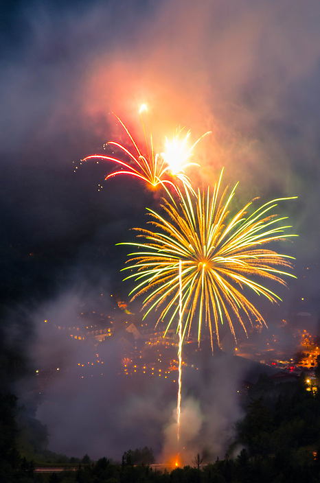 Fourth of July fireworks captured from a lofty perch, Waterville Valley, New Hampshire.