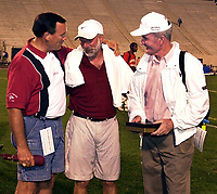 Arkansas Democrat-Gazette/JEREMY SCOTT<br />Arkansas' head coach John McDonnell (right) and assistant coach Dick Booth (left) both congradulate Stanford's head coach Vin Lananna on his first NCAA outdoor track and field title Saturday night at the NCAA outdoor track and field championships held at Duke University.  The Cardinal ended Arkansas' eight year winning streak at the outdoor meet. 6/4/00