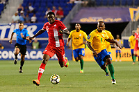 Harrison, NJ - Friday July 07, 2017: Alphonso Davies, Cedric Fabien during a 2017 CONCACAF Gold Cup Group A match between the men's national teams of French Guiana (GUF) and Canada (CAN) at Red Bull Arena.