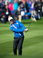 26.09.2014. Gleneagles, Auchterarder, Perthshire, Scotland.  The Ryder Cup.  Rory McIlroy (EUR) chips to the green during the Friday Fourballs.