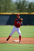 Kia Tigers second baseman Kim Gyu-sung (14) throws to first base during an Instructional League game against the Colorado Rockies on October 5, 2016 at Salt River Fields at Talking Stick in Scottsdale, Arizona.  (Mike Janes/Four Seam Images)