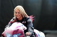 Nov. 11, 2011; Pomona, CA, USA; NHRA pro stock motorcycle rider Angie Smith during qualifying at the Auto Club Finals at Auto Club Raceway at Pomona. Mandatory Credit: Mark J. Rebilas-.