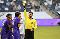 KANSAS CITY, KS - SEPTEMBER 23: Referee Victor Rivas shows a yellow card to Rodrigo Schlegel #15 of Orlando City during a game between Orlando City SC and Sporting Kansas City at Children's Mercy Park on September 23, 2020 in Kansas City, Kansas.