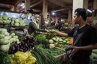 Yogyakarta, Java, Indonesia.  Woman Selling Vegetables, Beringharjo Market.