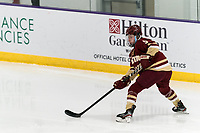 WORCESTER, MA - JANUARY 16: Savannah Norcross #5 of Boston College passes the puck during a game between Boston College and Holy Cross at Hart Center Rink on January 16, 2021 in Worcester, Massachusetts.