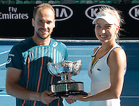 January 31, 2016: Elena Vesnina of Russian Federation and Bruno Soares of Brazil pose for photos after winning the Mixed Doubles Final against Coco Vandeweghe of United States of America and Horia Tecau of Romania on day fourteen of the 2016 Australian Open Grand Slam tennis tournament at Melbourne Park in Melbourne, Australia. Vesnina and Soares won 64 46 105. Photo Sydney Low