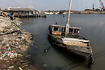 13 August 2019, Jakarta, Indonesia: A boat sits rotting in the sea just over the sea wall from the residential area of Muara Baru in North Jakarta.The city is sinking at such an alarming rate the Federal Government is planning to move the capital off the island of Java to alleviate some of the strain that is causing the city to sink so quickly such as the draining of the groundwater table. Picture by Graham Crouch/The Australian