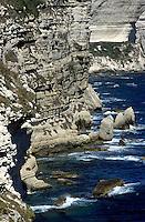 Waves crashing against calcareous cliffs, Bonifacio, Corsica, France.