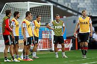 Arsenal trio Mesut Ozil , Per Mertesacker and Lukas Podolski of Germany