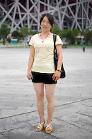 Fanyoumei, an independent worker, age 22, poses for a portrait in Beijing. Response to 'What does China mean to you?': 'It is my great home country. I am very proud to be Chinese.'  Response to 'What is China's role in the future?': 'To become a country of the world.'
