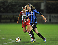 20131001 - VARSENARE , BELGIUM :  Brugge's Tine De Caigny (right) pictured with Antwerp Sophie Mannaert (left) during the female soccer match between Club Brugge Vrouwen and Royal Antwerp FC Ladies , of the fifth matchday in the BENELEAGUE competition. Tuesday 1 October 2013. PHOTO DAVID CATRY