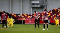 Barnsley players take a knee ahead of kick-off as Brentford players opt to stand during Brentford vs Barnsley, Sky Bet EFL Championship Football at the Brentford Community Stadium on 14th February 2021