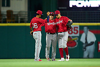 Worcester Red Sox outfielders Ricardo Cubillan (16), Tate Matheny (35) and Joey Meneses (65) celebrate after closing out a game against the Worcester Red Sox on September 4, 2021 at Frontier Field in Rochester, New York.  (Mike Janes/Four Seam Images)