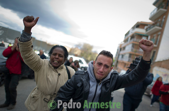 SPAIN, Madrid: Jonathan Torres (R), grandson of Vicente Torres, reacts after Bank representatives leave the area after trying to evict Vicente Torres from his apartment in Madrid on April 18, 2012. Vicente Torres, 73, who is severy ill and underwent a recent heart surgery, faces an eviction from his house. Eviction procedures in Spanish courts for unpaid mortgages and rent hit a record of 58,241 in 2011, a 21.2 percent rise over the previous year. Evictions have soared in Spain since the collapse of a property bubble in 2008 that triggered the country's economic crisis. (c) Pedro ARMESTRE