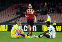 Thursday 27 February 2014<br /> Pictured L-R on the ground: Gokhan Inler of Napoli and Wilfried Bony of Swansea receive a stern word by match referee Ovidiu Alin Hategan (C)<br /> Re: UEFA Europa League, SSC Napoli v Swansea City FC at Stadio San Paolo, Naples, Italy.