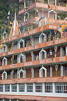India, Rishikesh.  Tera Manzil Hindu Temple, holding numerous shrines to various Hindu gods.  Shiva tridents on railings.