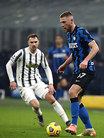 Calcio, Serie A: Inter Milano - Juventus FC , Giuseppe Meazza (San Siro) stadium, in Milan, January 17, 2021.<br /> Inter's Milan Skriniar (r)  in action during the Italian Serie A football match between Inter and juventus at Giuseppe Meazza (San Siro) stadium, January 17,  2021.<br /> UPDATE IMAGES PRESS/Isabella Bonotto