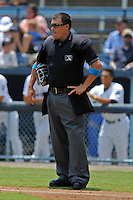 South Atlantic League umpire Cody Oakes during a game between the Lexington Legends and the Asheville Tourists at McCormick Field on June 16, 2013 in Asheville, North Carolina. The Tourists won the game 8-7. (Tony Farlow/Four Seam Images)