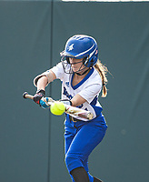 Amelia Haak (11) of Rogers lays down a bunt against Bentonville to get on base at Rogers High School, Rogers, Arkansas, on Tuesday, April 6, 2021 / Special to NWA Democrat Gazette