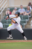 Tyler Sullivan (5) of the Kannapolis Intimidators squares to bunt against the Asheville Tourists at Intimidators Stadium on May 28, 2016 in Kannapolis, North Carolina.  The Intimidators defeated the Tourists 5-4 in 10 innings.  (Brian Westerholt/Four Seam Images)