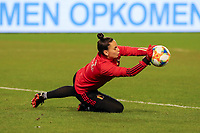 Belgian goalkeeper Nicky Evrard (21) makes a save during the warm up before a friendly female soccer game between the national teams of Belgium , called the Red Flames and The Netherlands , called the Oranje Leeuwinnen in a pre - bid tournament called Three Nations One Goal with the national teams from Belgium , The Netherlands and Germany towards a bid for the hosting of the 2027 FIFA Women's World Cup , on Thursday 18 th of February 2021  in Brussels , Belgium . PHOTO SPORTPIX.BE | SPP | SEVIL OKTEM