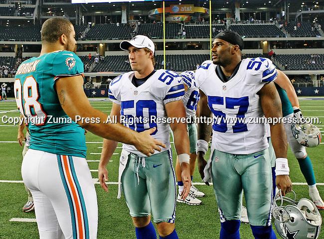Miami Dolphins defensive tackle Jared Odrick (98), Dallas Cowboys linebacker Sean Lee (50) and Dallas Cowboys linebacker Victor Butler (57) in action during the pre- season game between the Miami Dolphins and the Dallas Cowboys at the Cowboys Stadium in Arlington, Texas. Dallas defeats Miami 30 to 13...