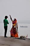 A holy man blesses an Indian man at a ghat in Varanasi, Uttar Pradesh, India.