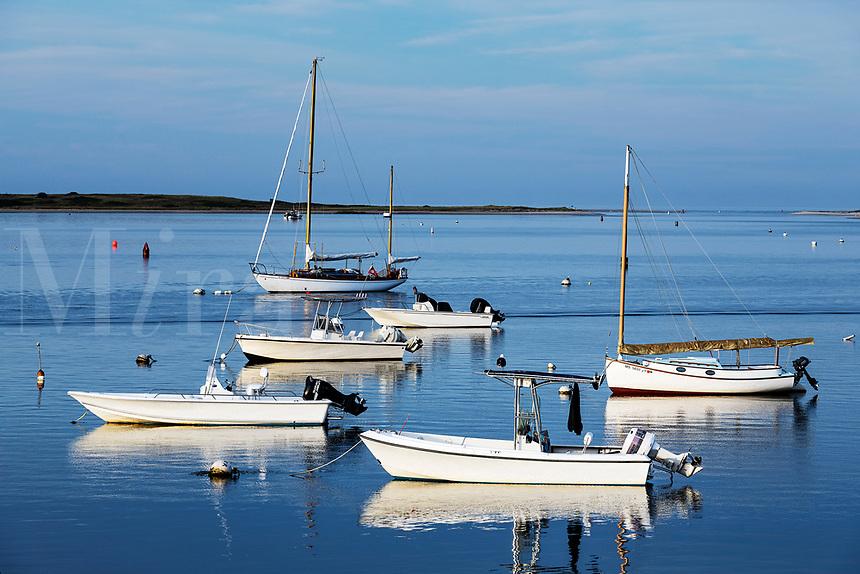 Anchored boats at sunset.