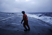 Crew on helicopter deck. Coastguard vessel KV Svalbard patrols the northermost waters of Norway, including around the islands that she is named after. The main task is inspecting fishing boats, but she also performs search and rescue missions, and environmental monitoring. © Fredrik Naumann