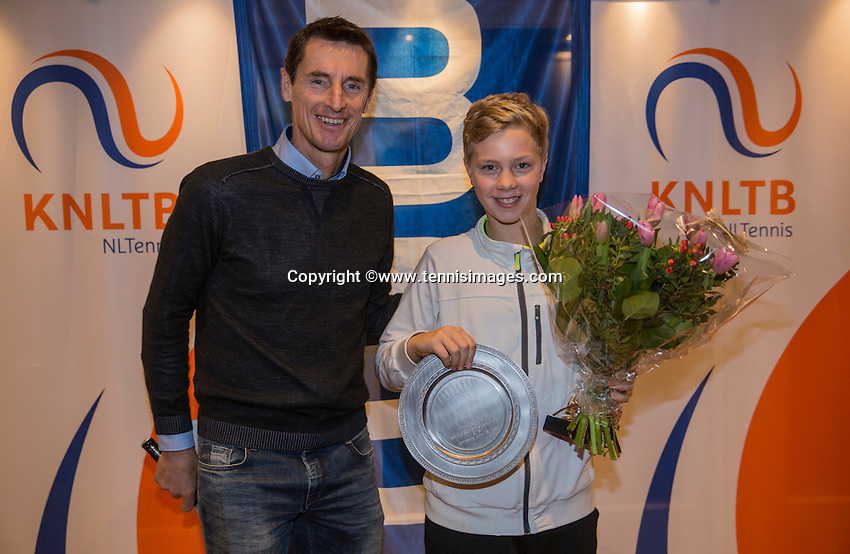 Hilversum, Netherlands, December 4, 2016, Winter Youth Circuit Masters Overall winner  boys 14 years Bastiaan Weststrate with Fedcup  captain Paul Haarhuis.<br /> Photo: Tennisimages/Henk Koster