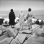 1977. Cadillac Mountain, Acadia National Park, Maine  Three women in trench coats.