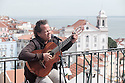 Lisbon, Portugal. 23.03.2015. A Fado singer entertains tourists at a viewpoint in the Alfama district.   © Jane Hobson.