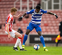 6th February 2021; Bet365 Stadium, Stoke, Staffordshire, England; English Football League Championship Football, Stoke City versus Reading; Lucas Joao of Reading under pressure from Sam Clucas of Stoke City