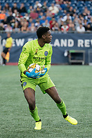 FOXBOROUGH, MA - SEPTEMBER 29: Sean Johnson #1 of New York City FC retrieves a ball near the goal during a game between New York City FC and New England Revolution at Gillettes Stadium on September 29, 2019 in Foxborough, Massachusetts.