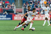 FOXBOROUGH, MA - JUNE 23: Sean Davis #27 of New York Red Bulls dribbles as Brando Bye #15 of New England Revolution defends during a game between New York Red Bulls and New England Revolution at Gillette Stadium on June 23, 2021 in Foxborough, Massachusetts.