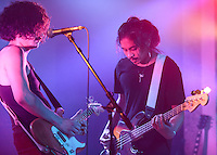 """Turquoise Boy singer/guitarist Derek Mangrobang  and bassist Winston Montecillo perform during the release party for the band's first album """"24 Hours a Night"""" at Williwaw. Photo by James R. Evans"""