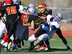 Pahranagat Valley's Garett Higbee brings down Whittell's Corey Huber during the first half of the NIAA DIV championship game against Whittell High at Dayton High School in Dayton, Nev., on Saturday, Nov. 21, 2015. PVHS won 54-28. (Cathleen Allison/Las Vegas Review Journal)