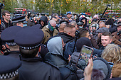 Police make arrests at Speakers' Corner after declaring a health incident due to overcrowding and failure to follow Covid-19 guidelines.  The unusually large crowd included clashes between supporters of Tommy Robinson (pictured right) and their opponents.  Hyde Park, London.