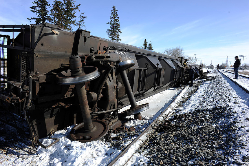 A train derailment in Estevan, Sask., attracts curious onlookers to the section of CP Rail where three grain cars tumbled off the rails Saturday February 28, 2015. MARK TAYLOR GALLERY.